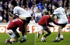 Boris Johnson tackles Germanys Maurizio Gaudino, during the Legends match, at the Madejski Stadium in Reading