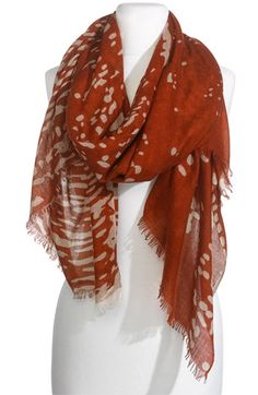 A lightweight burnt orange scarf.