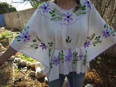 Check out this item in my Etsy shop https://www.etsy.com/listing/262714272/vintage-1970s-hand-embroidered-mexican