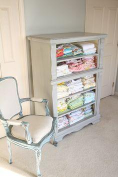 Trash to Treasure - Drawer-less dresser turned fabric storage or towel storage for a bathroom...