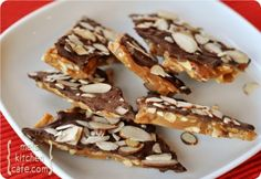 Almond Roca - looks so easy! 1 cup butter, 1 cup sugar, 3 oz slivered almonds, 2 cups chocolate chips, 3 oz sliced almonds