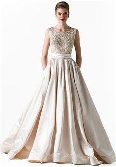 Ball gown with heavily beaded sleeveless bodice with bateau neckline and low square back, full pleated satin skirt; Color sampled: Cameo