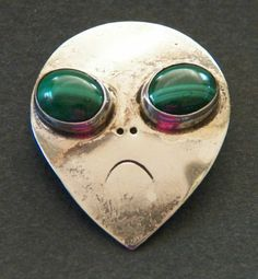 Vintage modernist Mexican alien brooch with malachite eyes