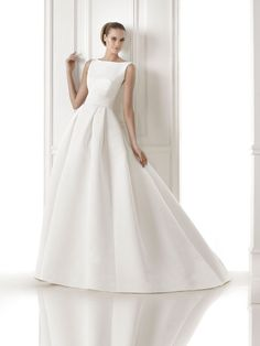 Simple chic wedding dress from Pronovias 2015 Bridal Collection's Preview, perfect to dress up or embody the classic bride http://storyboardwedding.com/pronovias-2015-bridal-collection-preview/