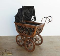 c 1900 original antique doll carriage / Victorian stroller / old hooded pram, hand made of wood and metal. Black canvas lining and moveable canvas hood. Wicker curls and wooden bead decor. Antique toy, beautiful doll display item / prop. Collectable doll accessory, vintage home decor. On offer   by SoVintastic on Etsy;-)