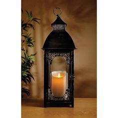Gallery page for Luminara real wax candles Lantern Lamp, Lantern Candle Holders, Candle Lamp, Candle Sconces, Flameless Candles, Led Candles, Luminara Candles, Lanterns Decor, Candle Lanterns