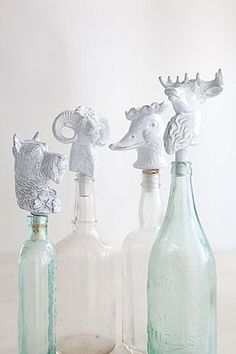 White chic animals on top of glass bottles