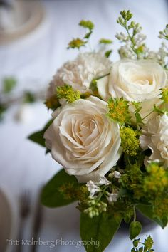 Beautiful little white fancy flower arrangement. By adding the white roses it becomes formal.