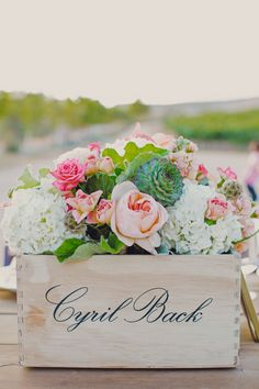 Wine crate centerpiece // Photo by  Lindsey Gomes Photography, see more: http://theeverylastdetail.com/mint-orange-california-vineyard-wedding/
