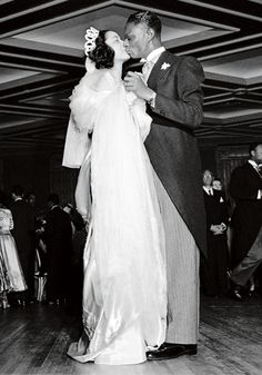 American jazz singers Nat King Cole and Maria Ellington share a kiss while dancing at their wedding reception in Harlem, New York on 28 March 1948. Cole and Ellington's wedding ceremony was held on Easter Sunday at Harlem's Abyssinian Baptist Church.