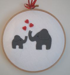embroidery hoop elephants/hearts.    via BoxRoomBazaar on Etsy.