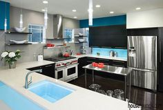 Cabinetry and glass backsplash combine for a custom look by Prime 1 Builders. #housetrends