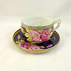 Japanese Eggshell Handpainted Porcelain Cup and Saucer.