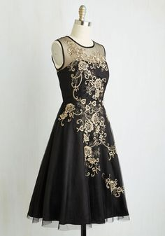 All the elements of your ideal dress marvelously mingle on this black fit and flare! Against your skin, a satiny frock with transparent straps sways, veiled by a sheer mesh overlay that welcomes blossoming gold embroidery. Spin this illusion-neckline style to your next event and prep to be met with swoons!