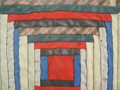 Variation on Log Cabin Pattern, red, mauve blue, white, green, grey, and black colors, small strips in squares with red square in centre. Brown and orange plaid backing Photo Buttons, Search People, Black Colors, Online Collections, Museum Collection, Mauve, Squares, Centre, Objects