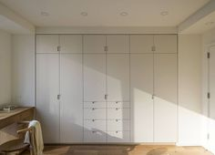 Closset Alternative - custom builtin storage in a small apartment by Workstead