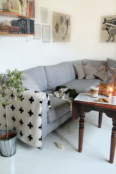 www.an-magritt.no Big corner sectional karlstad sofa from ikea with a lovely black and white cross or crux blanket
