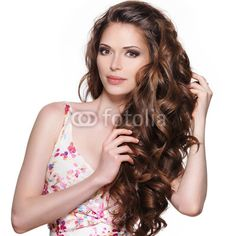 Beautiful adult woman with long brown curly hair.