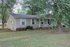 Gorgeous 3 bd, 2 bath vinyl sided home. Beautiful hardwood floors through-out, stainless steel appliances, tilt out windows, 1 car attached garage, shop building with electric. Large lot with fruit trees in Poplar Bluff MO