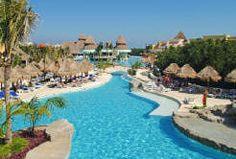 An all-inclusive with a lazy river, so you can float for hours with a drink in your hand. // Iberostar Playa Paraiso, Mayan Riviera, Mexico