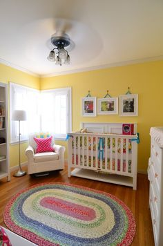 Yellow Nursery w/ white furniture good for a surprise sex of the baby