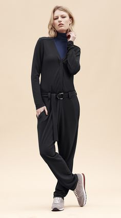 Go for this black V-Neck Crêpe Belted Jumpsuit paired with sneakers. An easy look to pull off in autumn.
