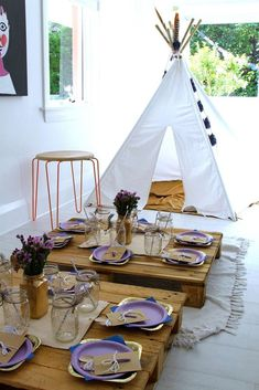 Teepee at a boho feather birthday party! See more party ideas at CatchMyParty.com!