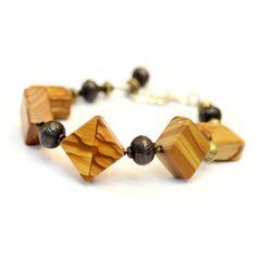 Single Row Wood-like Gem Stone Antique Bronze/Gold Bead Bracelet, Gem... (€17) ❤ liked on Polyvore featuring jewelry, bracelets, wood bangles, gem jewelry, beaded jewelry, beaded bangles and bronze jewelry