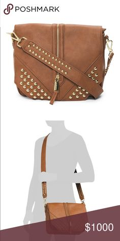 Steve Madden Studded Crossbody Bag Gorgeous bag!!!  The brown with gold studs is really stylish and the zipper detail adds a cool vibe.  Front flap has a magnetic closure.  Crossbody strap is detachable.  Bag has 1 zipper pocket, 3 interior pockets and 1 back pocket - perfect for organizing your everyday essentials! Steve Madden Bags Crossbody Bags