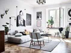 Like a true Scandinavian home this Gothenburg apartment is mainly decorated in grey, black and white with a lot of artwork decorating the walls. There's also quite a bold choice in this cozy apartment