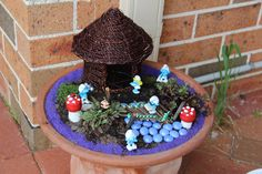 What could be better than imaginative play featuring Papa Smurf in a container garden Smurf Village? A fun take on the Fairy Garden trend.