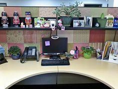 This lady decorated the walls of her cubicle with scrapbook paper. I think it made it sleek and pretty. :) I might like to copy her idea sometime.