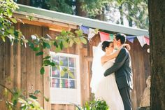 bride and groom embrace as david kisses his new wife