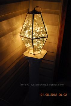 Neat little idea. Christmas lights and old porch light.