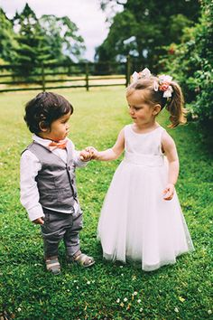 Adorable tiny page boy & flower girl | Dena and Rob's Pretty Summer Wedding by Campbell Photography | www.onefabday.com