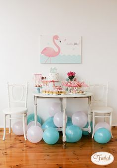 Host a flamingo themed first birthday party with bright and fun colors.