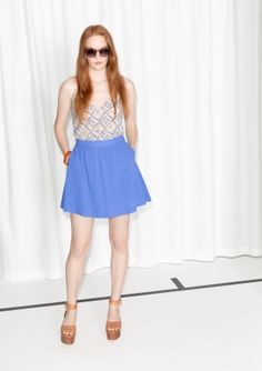 Made from a cotton blend with a crisp feel, this feminine skirt features a classic a-line shape