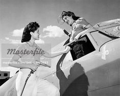 1940s TWO WOMEN WARTIME WORKERS ASSEMBLE VEGA AIRCRAFT ROSIE RIVETER WOMAN WORKER FACTORY AIRPLANE WW2 WWII WORLD WAR 2     – Image © ClassicStock / Masterfile.com: Creative Stock Photos, Vectors and Illustrations for Web, Mobile and Print