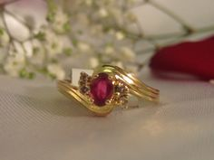 Oval cut ruby & diamond ring in 14k. This ring is beautiful and feminine and would look great on your finger! It is all set in 14k yellow gold. The is a great price for such a pretty ring! $130