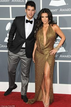 In happier times: Kim and Rob Kardashian at the 2011 Grammy Awards in Los Angeles