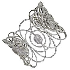 Cuff | Goldiva Designs.  18 kt gold, white gold and diamonds.