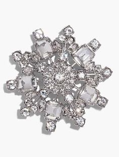 A festive crystal snowflake brooch is an extra hint of season-right sparkle.