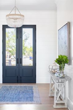 Bright open foyer with navy blue front doors Bright open foyer wi. Bright open foyer with navy blue front doors Bright open foyer with navy blue front Rustic Farmhouse Entryway, Foyer Decorating, Stairs Design Interior, Front Door Entryway, Interior, Navy Front Door, Front Entrance Decor, Home Decor, Doors Interior