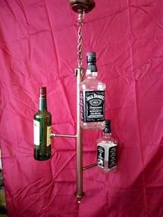 Jack and Jamesom lightning together . by Alex Pospotikis Jack Daniels, Lightning, Vodka Bottle, Whiskey, Lamps, Bronze, Lights, Handmade, Design