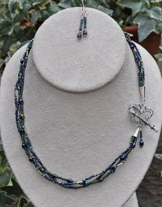Jewelry - Necklaces - Braided Metallic Glass Bead Necklace with a butterfly clasp and matching earrings by JewelryArtByGail SOLD
