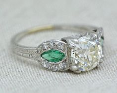Antique 1.82 Carat Old European Cut Diamond Edwardian / Art Deco Platinum Engagement Ring with Natural Emerald Side Stones and Engraving