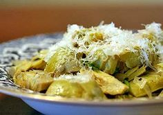 Recipe for baby artichokes, sauteed with onions and garlic, served with grated Parmesan cheese.