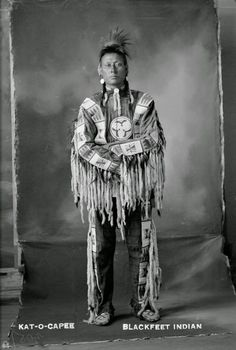 """KAT-O-PEE"" -- Blackfoot Indian dressed in beautiful fringed beaded buckskin"