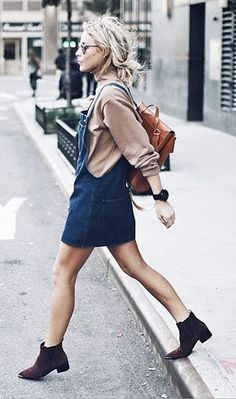 Overall mini dress, turtleneck sweater, leather backpack and suede booties