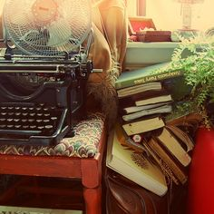 Typewriters and books must be friends. -Bookshelf Porn